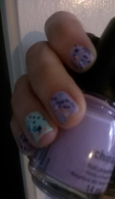 China Glaze in Lotus Begin (purple), At Vase Value (blue) and Glitter Up Top coat