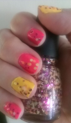 China Glaze Thistle Do Nicely (pink), Metro Pollen-tin (orange) and Glimmer More topcoat